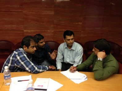 Participants from Aptech discussing a presentation